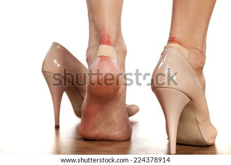 Closeup of a woman's heel with a blister plaster on - stock photo