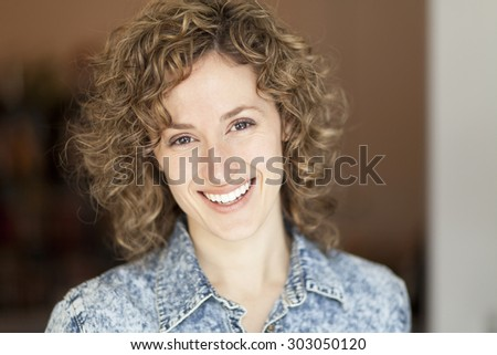 Closeup of a woman smiling at the camera - stock photo