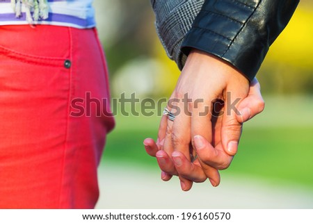 Closeup of a women couple holding hands together - stock photo