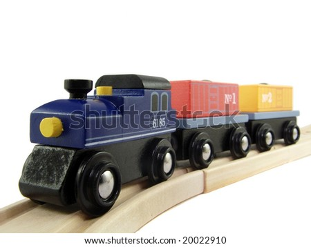 Closeup of a wooden toy train isolated on white - stock photo