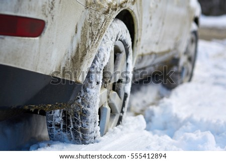 Closeup of a 4x4 SUV wheels in the snow