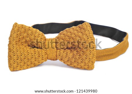 closeup of a yellow bow tie on a white background - stock photo