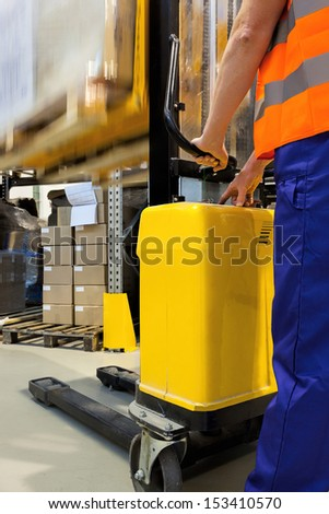 Closeup of a yellow forklift with an operator