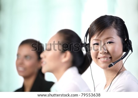 Closeup of a young Asian customer service woman smiling