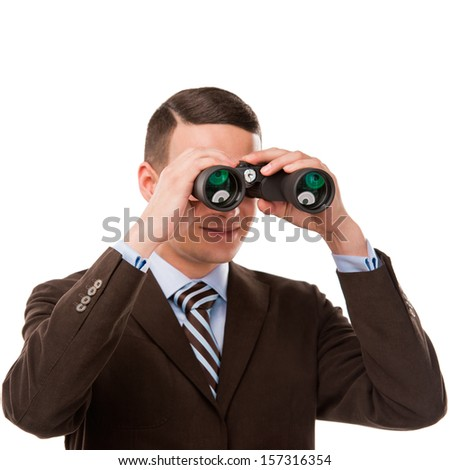 Closeup of a young business man looking through binocular isolated on white background - stock photo