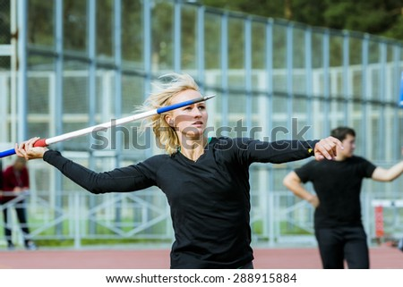 closeup of a young girl athlete javelin thrower tries in javelin. competitions at stadium - stock photo