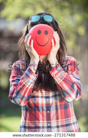 Closeup of a young girl with a balloon face vertical - stock photo