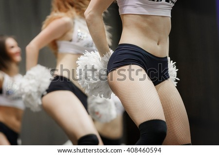 closeup of a young group of girls cheerleaders performance at competitions - stock photo