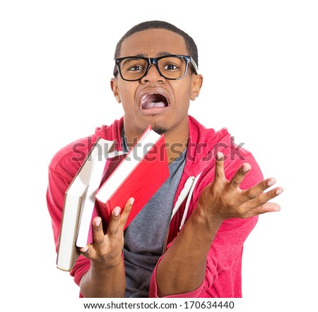 Closeup of a young handsome man, wearing big glasses, holding books, anxious in anticipation of finals, exam test, isolated on white background. Negative facial expressions, feelings, emotions - stock photo