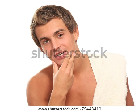 Closeup of a young man after shaving - stock photo