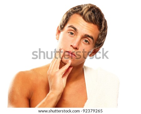 Closeup of a young man after shaving , isolated on white background - stock photo