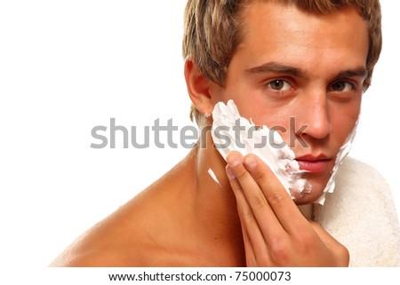 Closeup of a young man shaving - stock photo