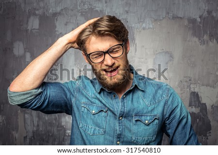Closeup of a young man who forgot something important - stock photo