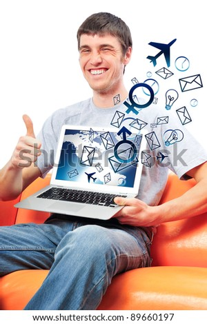 Closeup of a young smiling business man sitting at his home office and using his modern laptop to do his work