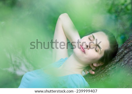 Closeup of a young woman day-dreaming