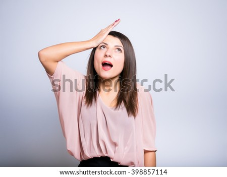 closeup of a young woman made a mistake - stock photo