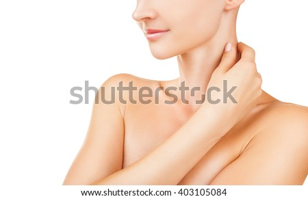 Closeup of a young woman regards her neck isolated on white background - stock photo