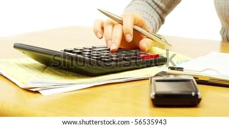 Closeup of a young women calculating bills - stock photo