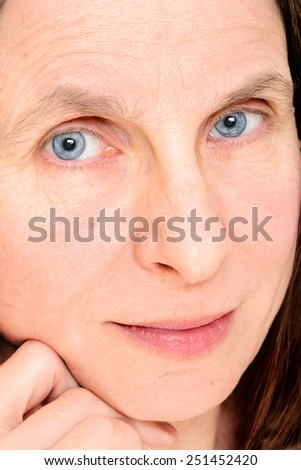 Closeup of adult woman face with soft contact lenses on the eyes - stock photo