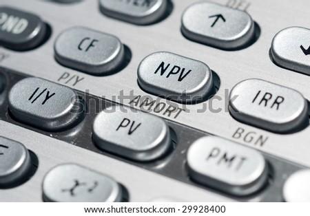 closeup of advanced financial analysis calculator background - stock photo
