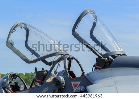 Closeup of aircraft canopy against a blue sky