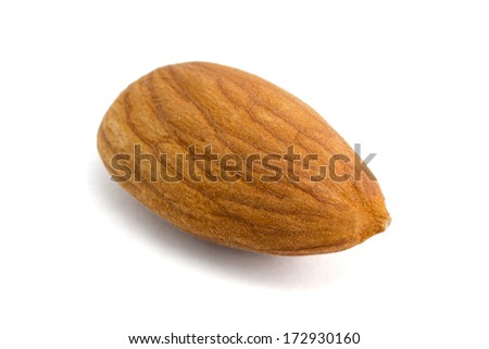 Closeup of almond nut isolated on white background