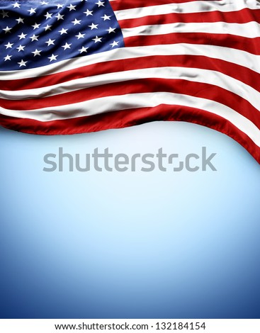 Closeup of American flag on blue background - stock photo