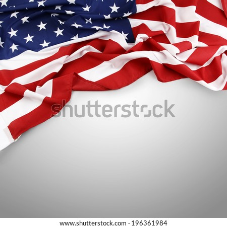 Closeup of American flag on grey background - stock photo