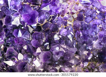 Closeup of amethyst crystals makes for cool background. - stock photo