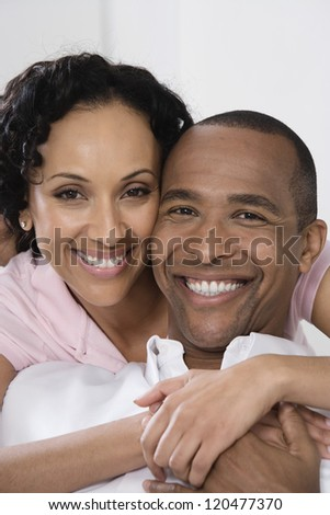 Closeup of an African American couple smiling together - stock photo