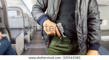 closeup of an armed terrorist in a commercial airplane - stock photo