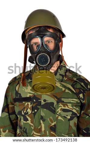 Closeup of an Army Soldier with Green Helmet And Gas Mask - stock photo