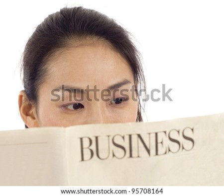 Closeup of an Asian woman reading a business newspaper isolated over white background - stock photo