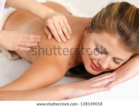Closeup of an attractive young woman receiving massage - stock photo