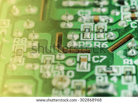 Closeup of an electronic printed broken circuit board with many electrical