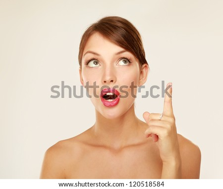 Closeup of an emotional young woman showing up isolated on white background - stock photo