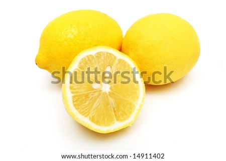 Closeup of an half lemon and others on white background.