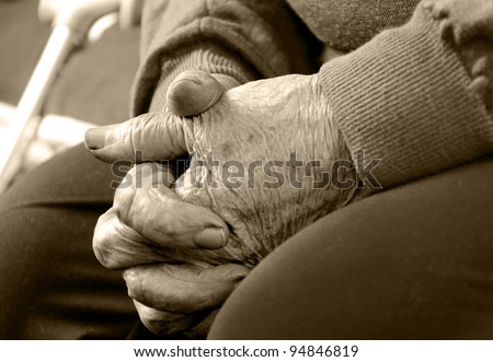 Closeup of an old woman's hands joined , focus on hands - stock photo
