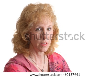 closeup of an older attractive woman in pink top over a white background - stock photo