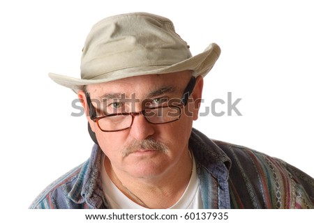 closeup of an older man in a floppy hat isolated over white background