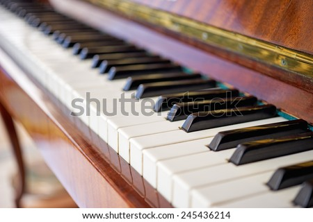 Closeup of antique piano keys and wood grain - stock photo