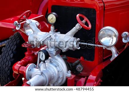 Closeup of antique red fire engine hose cocks and valves - stock photo