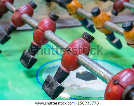 Closeup of antique table football - stock photo