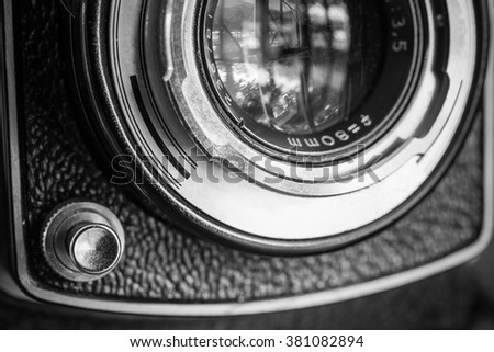 Closeup of apart of old film cameras with free copy space, vintage background. - stock photo