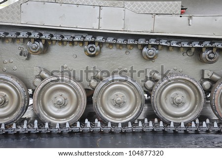 Closeup Of Army Tank Track Wheels - stock photo