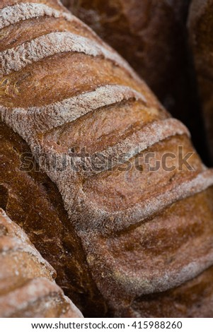 Closeup of artisan french breads. French baguettes, crispy looking, whole wheat bread in rustic basket
