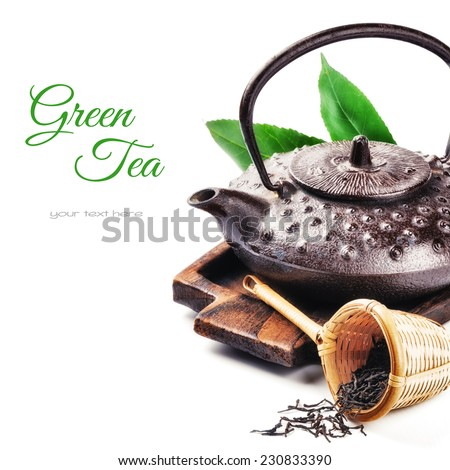 Closeup of asian teapot and dried tea. Health and diet concept - stock photo