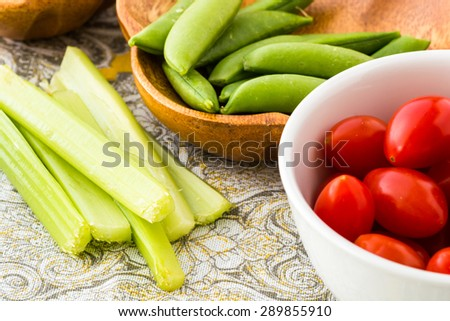 Closeup of assorted cut vegetables and dip. - stock photo