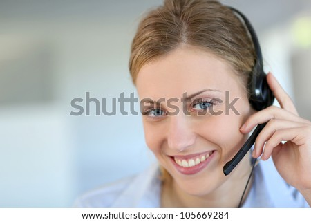 Closeup of attractive blond customer service assistant - stock photo