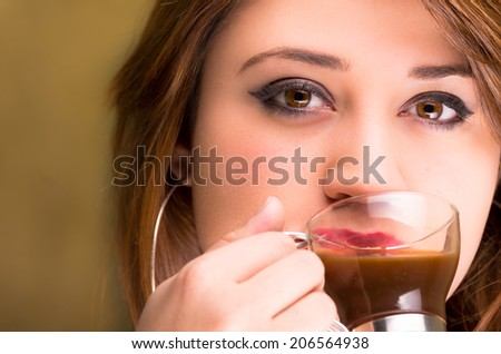 closeup of attractive girl holding cup of coffee